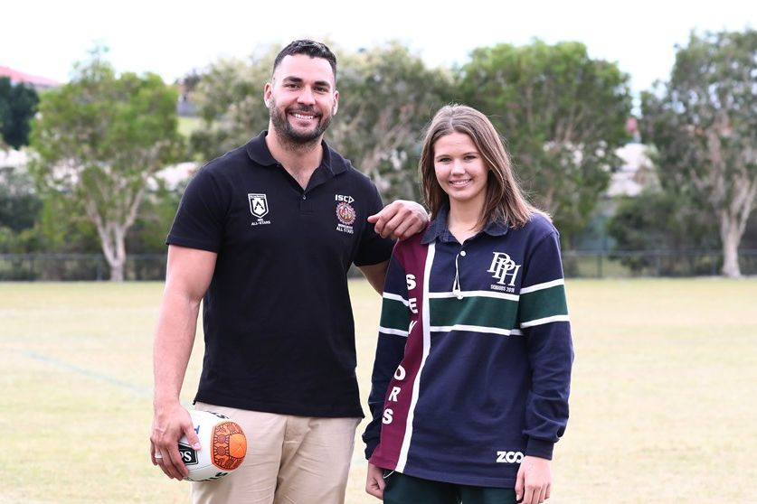 NRL Young Person of the Year, Holly Summers, with Titans captain Ryan James. ©NRL Photos